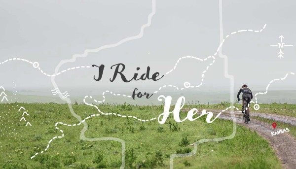 Graphic reads I Ride For Her over dramatic photo of man riding he bike on Kansas gravel roads