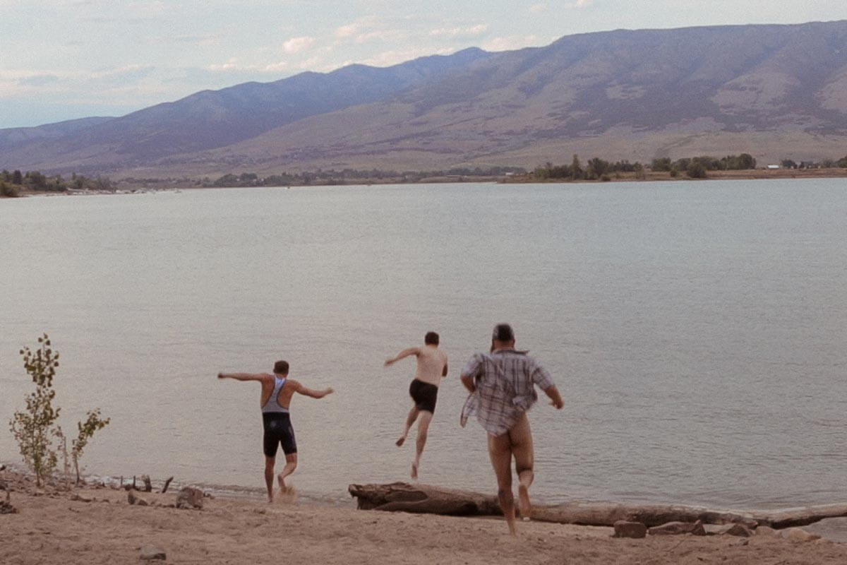 The men jumping into a lake in Utah, Kyle's ass is out