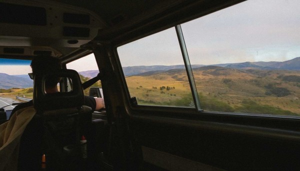 Ty Hathaway of Golden Saddle Cyclery rides in a Eurovan in Utah