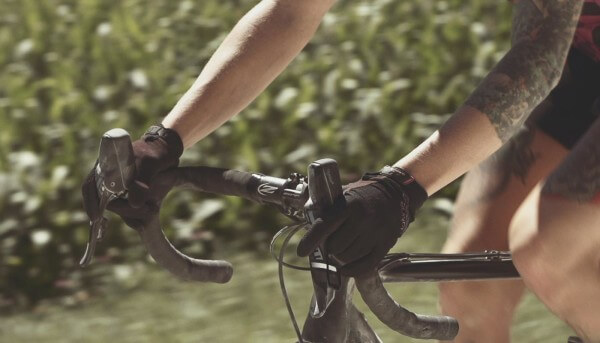 Close-up of bike shifters on gravel road